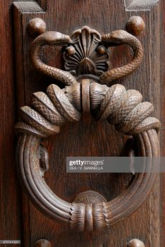 Door knocker, detail of a main door in the Marais district, Paris, France.